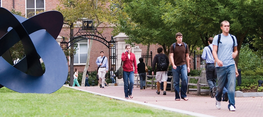 Students walk through college campus.