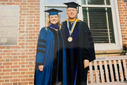 Energy scientist Maggie Teliska, PhD '04, (left) with her faculty mentor Professor of Chemistry David Ramaker (right), who passe